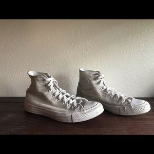 High Top White Converse All Stars.